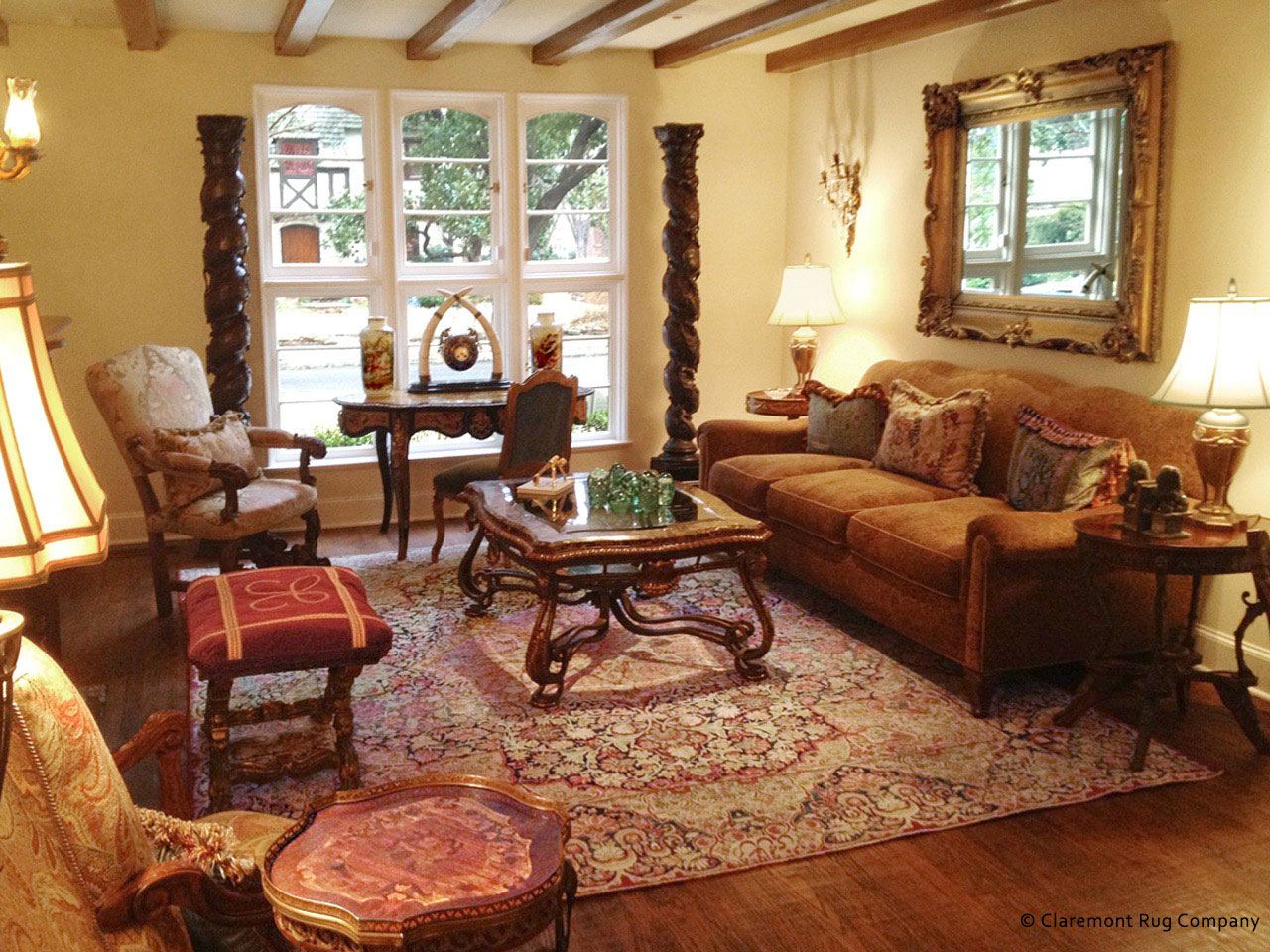 antique persian laver kirman carpet in elegant traditional texas home